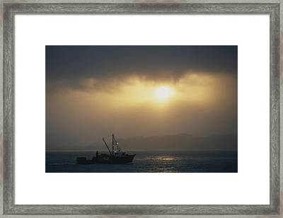 A Fishing Boat Heads Out To Sea Framed Print by Norbert Rosing