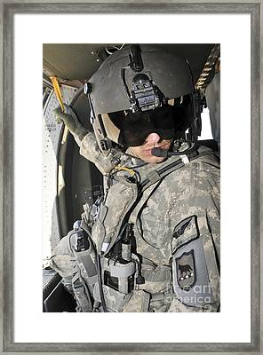 A Flight Medic Conducts A Daily Framed Print by Stocktrek Images