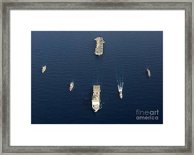 A Formation Of Ships At Sea Framed Print by Stocktrek Images