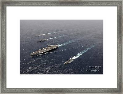 A Formation Of Ships Traveling At Sea Framed Print