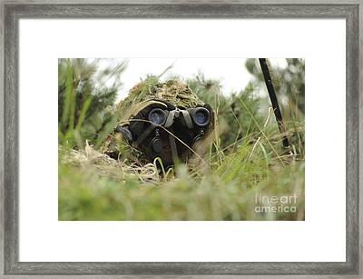 A German Bundeswehr Soldier Camouflages Framed Print by Stocktrek Images