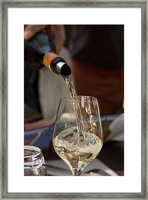 A Glass Of White Wine Being Poured Framed Print
