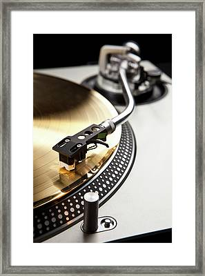 A Gold Record On A Turntable Framed Print by Caspar Benson