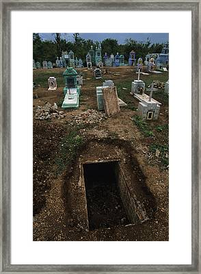 A Graveyard Has Handpainted Stones Framed Print by Stephen Alvarez