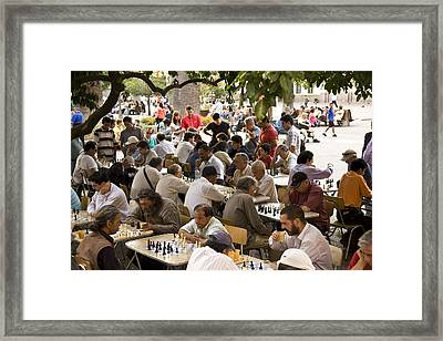 A Group Of Men Playing Chess In Plaza Framed Print by Richard Nowitz