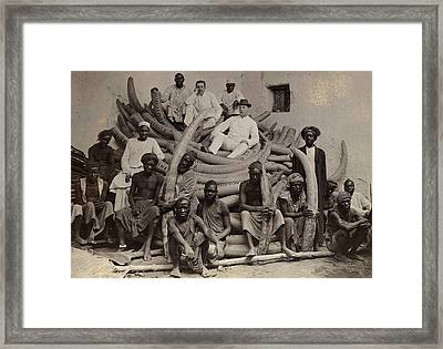 A Group Of Men Sit Atop A Pile Of Ivory Framed Print
