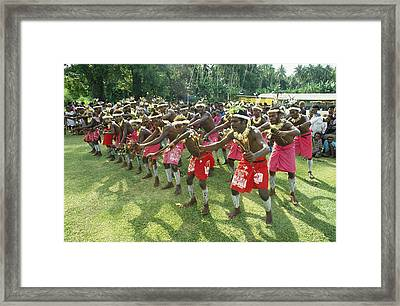 A Group Of New Guinean Men Performing Framed Print