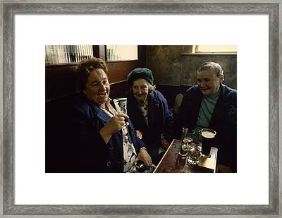 A Group Of Old Friends Gathers Framed Print by Cotton Coulson