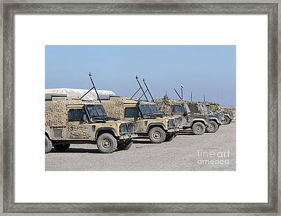 A Group Of Snatch Land Rover Patrol Framed Print by Andrew Chittock