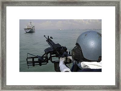 A Gunner Keeps His Sight Framed Print by Stocktrek Images