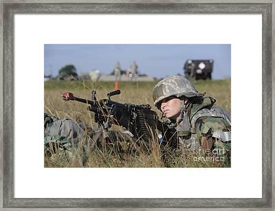 A Heavy Gunner Prepares To Fire Framed Print