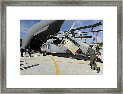 A Helicopter Is Loaded Onto A C-17 Framed Print