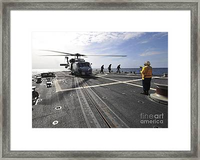 A Helicpter Sits On The Flight Deck Framed Print by Stocktrek Images