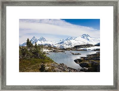 A High Alpine Lake On A Sunny Afternoon Framed Print