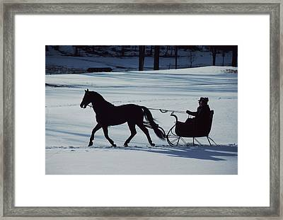 A Horse-drawn Sleigh Ride At Twilight Framed Print by Ira Block