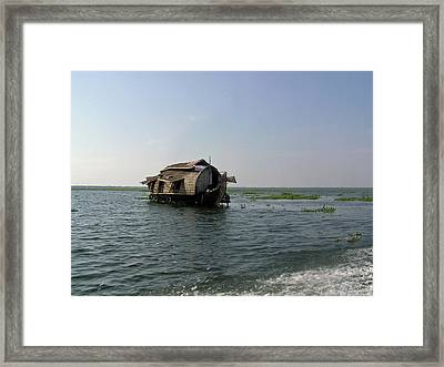 Framed Print featuring the photograph A Houseboat Moving Placidly Through A Coastal Lagoon In Alleppey by Ashish Agarwal