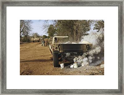 A Humvee Burns After A Simulated Framed Print by Stocktrek Images
