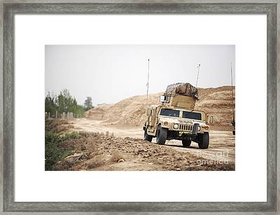 A Humvee Conducts Security Framed Print by Stocktrek Images