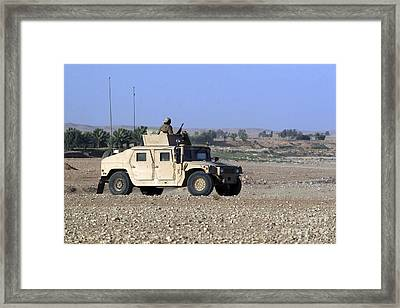 A Humvee Filled With Marines Conducting Framed Print by Stocktrek Images