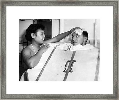 A Japanese Masseuse Applies A Cold Framed Print