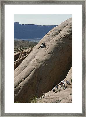 A Jeep Drives Down A Slick Rock Framed Print by James P. Blair