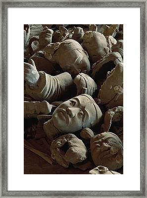 A Jumbled Heap Of Terra-cotta Heads Framed Print