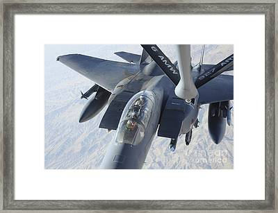 A Kc-135 Stratotanker Refuels An F-15e Framed Print by Stocktrek Images