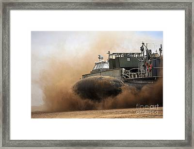 A Landing Craft Air Cushion Coming Framed Print by Stocktrek Images