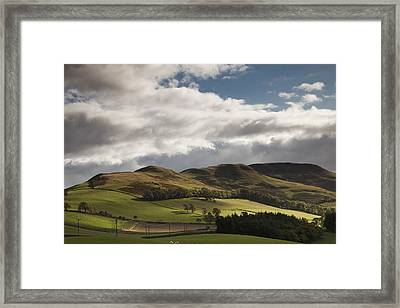A Landscape With Rolling Hills And Framed Print by John Short
