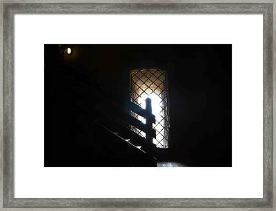 A Light In The Darkness Framed Print