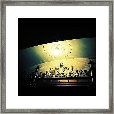 A Light In The Village Framed Print