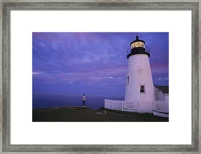 A Lighthouse Visitor Enjoys A Twilight Framed Print