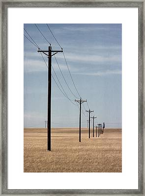A Line Of Telephone Poles Travels Framed Print by George Grall