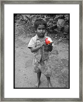 A Little Boy Framed Print by Jino Blessil