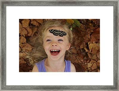 A Little Girl Reacts To A Butterfly Framed Print by Joel Sartore
