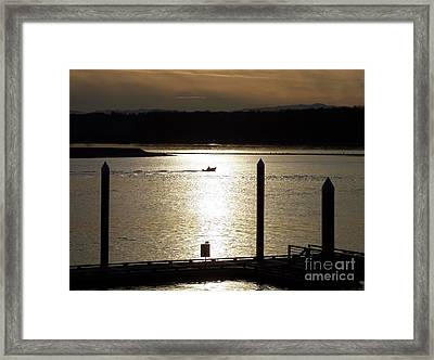 A Lone Boat At Sunset Framed Print by Chalet Roome-Rigdon