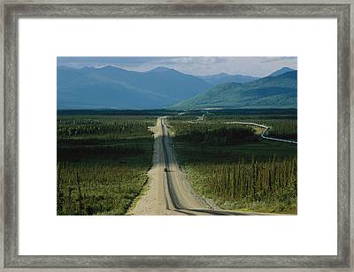 A Lone Truck Moves Down The Dalton Framed Print by Melissa Farlow