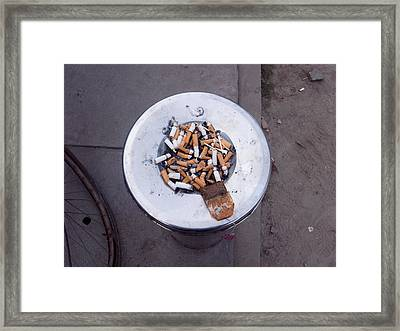 Framed Print featuring the photograph A Lot Of Cigarettes Stubbed Out At A Garbage Bin by Ashish Agarwal
