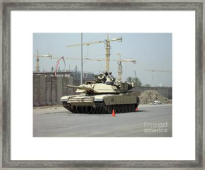 A M1 Abram Sits Out Front Of The New Framed Print by Terry Moore