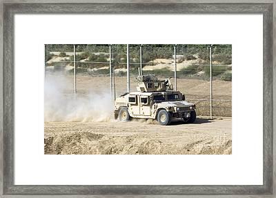 A M1114 Humvee Patrols The Perimeter Framed Print
