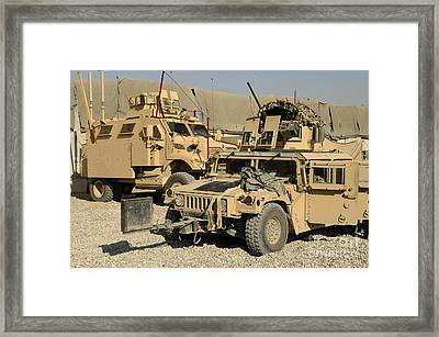A M1114 Humvee Sits Parked In Front Framed Print