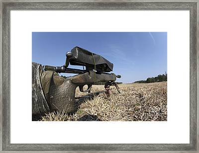 A M40a3 7.62mm Sniper Rifle Sits Ready Framed Print by Stocktrek Images