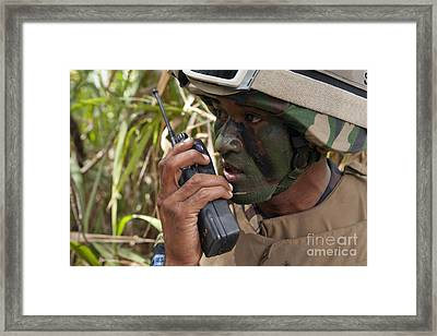 A Malaysian Paratrooper Maintains Framed Print by Stocktrek Images