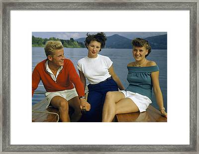 A Man And Two Young Women Sit Framed Print