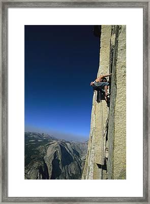 A Man Climbing Half Dome, Yosemite Framed Print by Jimmy Chin