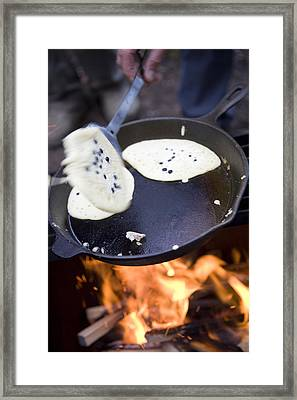 A Man Cooks Pancakes With Freshly Framed Print by Taylor S. Kennedy