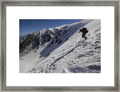 A Man Hikes Up Tuckermans Ravine Framed Print by Tim Laman