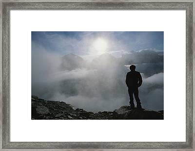 A Man In Silhouette Looking Framed Print by Gordon Wiltsie