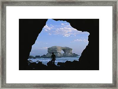 A Man Silhouetted Against La Portada Framed Print by Joel Sartore
