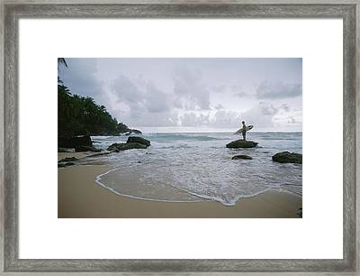 A Man Stands With A Surfboard Framed Print